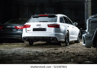 Kiev, Ukraine - 14 May 2014: white colored Audi RS6 tuning sport-car. It surrounded by other autos. Editorial photo. Shoot from the back.