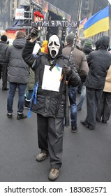 """KIEV, UKRAINE - 16 MARCH 2013: Unknown demonstrators stage a strike with words """"Putin, I came for you"""" against the Russian intervention in Crimea on March 16, 2013 in Kiev, Ukraine."""