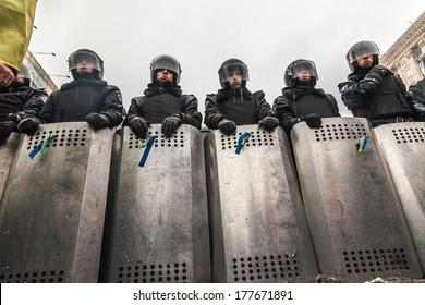 "KIEV, UKRAINE - 18 FEBRUARY: Protest against ""Dictatorship"" in Ukraine turns violent on Euromaydan in Kiev. Internal troops waiting rebel attack on 18 February, 2014 in Kiev, Maidan, Ukraine."