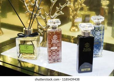 KIEV, UKRAINE – 19 September, 2018: Many bottle of various men woman perfume in retail shop window display showcase. Arabic turkish Perfume Golden Judi retail shop, market, store
