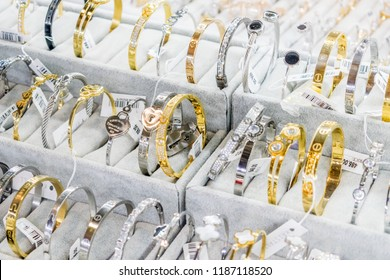 KIEV, UKRAINE – 19 September, 2018: Stylish beautiful bijouterie hanging on the stand in the accessories store. Various Jewelry bijouterie show in retail shop window display showcase