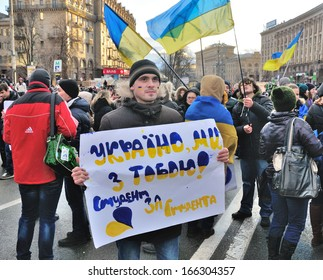 KIEV, UKRAINE � 2 DECEMBER 2013: Unknown demonstrators blockade the Independence square with poster '��Ukraine we are with you! Student for student' on December 2, 2013 in Kiev, Ukraine.