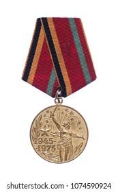 Kiev, Ukraine, 22 April 2018. Wintage World War 2 soviet anniversary medal. Statue of mother of motherland with sword 1975