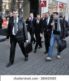 KIEV, UKRAINE - 22 FEBRUARY 2013: Minister of Foreign affairs of Poland Radoslaw Sikorski and ambassador in Ukraine H.Litwin with bodyguards walk on city street on February 22, 2013 in Kiev, Ukraine