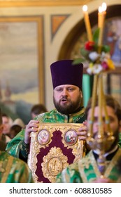 KIEV, UKRAINE - 22 March 2017: The Divine Liturgy at the Kiev Holy Presentation Monastery. The deacon reads the Gospel in the temple.