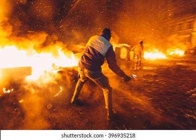 Kiev, Ukraine - 23 January, 2014: Protester throws a Molotov cocktail to stop the riot police, because Ukrainian police want to storm the main anti-government protest camp in the Kiev