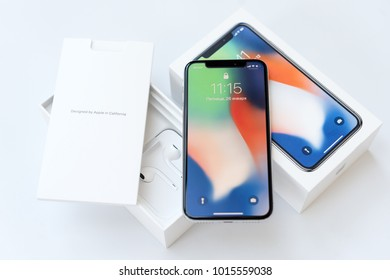 Kiev UKRAINE - 26 JANUARY, 2018: New Iphone X smartphone model close up. Newest Apple Iphone 10 mobile phone device on white branded Apple box on white table in store.