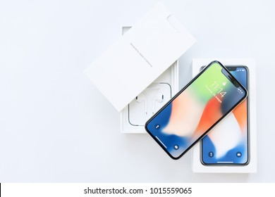 Kiev, UKRAINE - 26 JANUARY, 2018: New Iphone X smartphone model close up. Newest Apple Iphone 10 mobile phone device on white branded Apple box on white table in store.