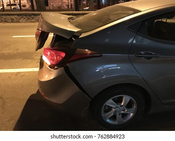 Kiev, Ukraine - 26, November, 2017: a broken car at the scene of an accident in the evening on a city street.