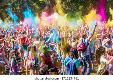 Kiev, Ukraine, 6.09.2018:  Many people at the festival in Holi's bright paint. A crowd of young men and women throw loose color paint at each other.