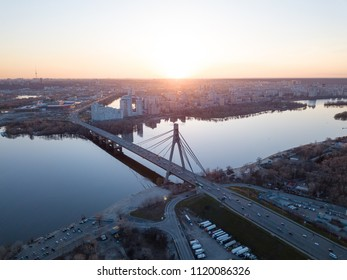 Kiev, Ukraine: 7 April, 2018 - City landscape from a bird's-eye view overlooking North Bridge (Moscow Bridge) across Dnieper River, photo from drone