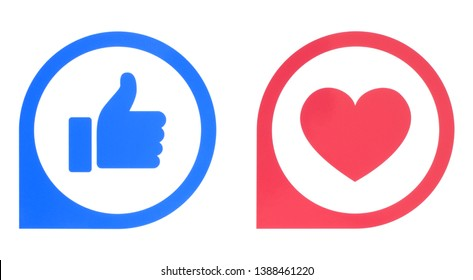 Kiev, Ukraine - Aplril 25, 2019: Facebook Like and Love buttons pointers of Empathetic Emoji Reactions printed on white paper