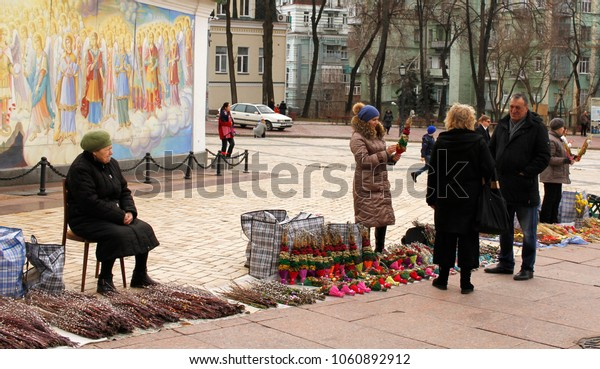 Kiev, Ukraine. Apr 01 2018. Women selling decorated branches of pussy willow in front of the St. Michael´s golden-domed monastery on Easter Willow Sunday.