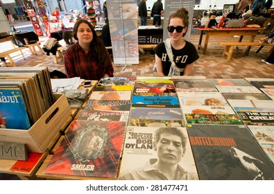KIEV, UKRAINE - APR 26: Two young girls sell vintage vinyl records by Bob Dylan, U2 and other during Kyiv Music Market on April 26, 2015. With population 2,850,000, Kiev the 8th largest city in Europe