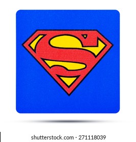 KIEV, UKRAINE - APRIL 01, 2015:  The superhero comic figure Superman sign logo printed printed on paper and placed on white background. Superman-Superhero comics, which are produced by DC Comics.