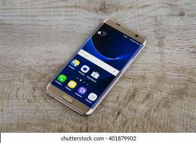 Kiev, Ukraine - April 01, 2016: Studio shot of a Gold Samsung Galaxy S7 Edge smartphone, with Exynos 8890 and 5.1nch display, 2560x1440px resolution.