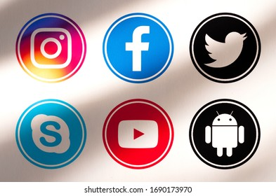 Kiev, Ukraine - April 01, 2020: Set of most popular social media icons:  Facebook, Instagram, Twitter, Skype, YouTube, Android,  printed on paper.