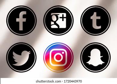 Kiev, Ukraine - April 01, 2020:Set of most popular social media icons:   Facebook, Instagram, Twitter, Google Plus, Tumblr, Snapchat  printed on paper.