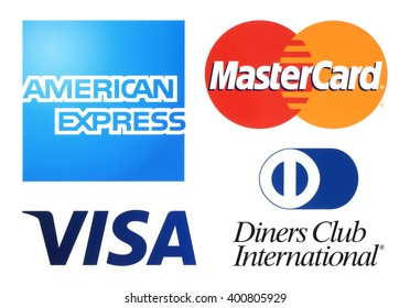 Kiev, Ukraine - April 04, 2016: Collection of popular payment system logos printed on white paper: American Express, MasterCard, Visa and Diners Club International