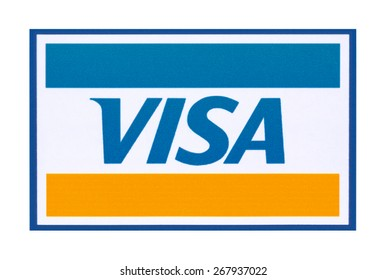 KIEV, UKRAINE - APRIL 08, 2015:  Visa  logo printed on the paper and placed on white background.Visa - American multinational company providing services of payment operations.