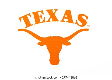 KIEV, UKRAINE - APRIL 08, 2015: Texas Longhorns university logo  printed on paper and placed on white background.  University of Texas at Austin.