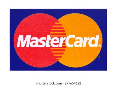 KIEV, UKRAINE - APRIL 08, 2015  Mastercard  logo printed on the paper and placed on white background. MasterCard Worldwide American multinational company providing services of payment operations.