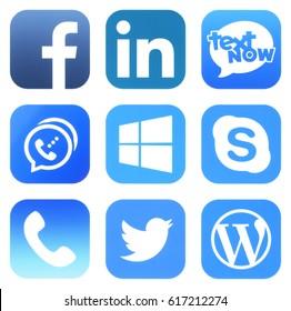 Kiev, Ukraine - APRIL 08, 2017: Popular social media icons such as: Facebook, LinkedIn, TextNow, Dingtone, Skype, Twitter, WePhone, WordPress and Windows printed on white paper.
