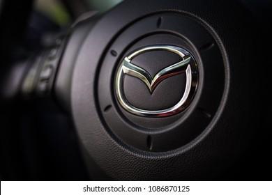 KIEV, UKRAINE - APRIL 10, 2018: Mazda car logo on the steering wheel