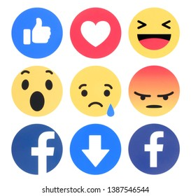 Kiev, Ukraine - April 11, 2019: Facebook 6 Empathetic Emoji Reactions printed on white paper. Facebook is a well-known social networking service.