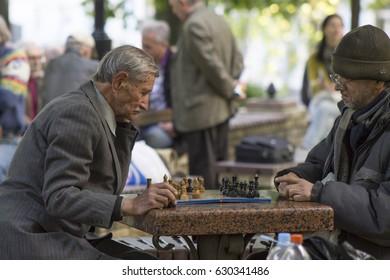 Kiev, Ukraine - April 11: Old men are playing chess in a park, on April 11, 2016 in Kiev, Ukraine