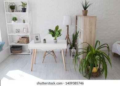 Kiev, Ukraine - April 12, 2019: Room in the Scandinavian white style. Desktop for laptop. - Shutterstock ID 1409385746
