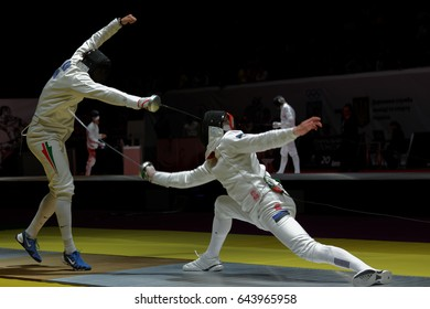 KIEV, UKRAINE - APRIL 14, 2012: One of fights during World Fencing Championship. It was the only events were the women's team sabre and men's epee team in 2012
