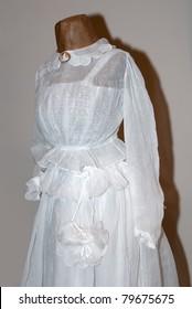 KIEV, UKRAINE - APRIL 16: An original white woman dress is on display at the Marina Ivanova's private collection exhibit on April 16, 2011 in Kiev, Ukraine.