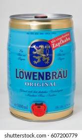 KIEV, UKRAINE - APRIL 17, 2016: Lowenbrau small barrel of beer can closeup against white. Lowenbrau is a brewery founded in Munich around 1383, its name means lion's brew in German.