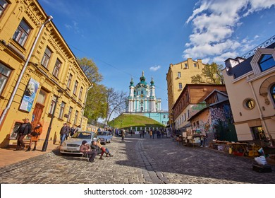 KIEV, UKRAINE - APRIL 17, 2017: people and gift shops on Andriyivskyy Descent in Kiev city in spring. This street connecting Upper Town district and the historical commercial Podil district