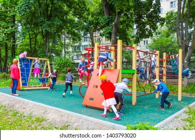 KIEV, UKRAINE - APRIL 17, 2019: Many active little children playing on the playground in kindergarten. Joyful children on the playground