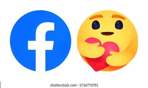 Kiev, Ukraine - April 18, 2020: Facebook icon with new Care Empathetic Emoji Reaction, printed on white paper. Facebook is adding a hug reaction to show you care during the COVID-19 pandemic