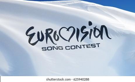 KIEV UKRAINE - APRIL 2017: Eurovision Song Concert logo flag waving against blue sky, editorial image, close up view.
