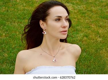 Kiev, Ukraine - April 2017: Woman photographer take a photo shot a beautiful brunette model. illustrative editorial. Kiev, Ukraine