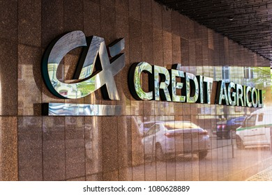 KIEV, UKRAINE - April 2018:  Credit Agricole bank logo sign on the tiled building wall in Kiev center, Ukraine