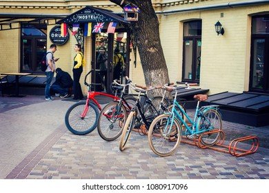 KIEV, UKRAINE - April 2018: Hostel courtyard with bicycles for rent near the entrance, Hostel in Kiev center, Podil, Ukraine