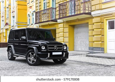 Kiev, Ukraine; April 21, 2015. Mercedes-Benz G55 AMG on the background of old yellow houses. Editorial photo.