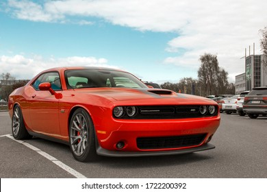 Kiev, Ukraine - April 21, 2020: Muscle car Dodge Challenger SRT8 392 HEMI in the parking lot. Red car