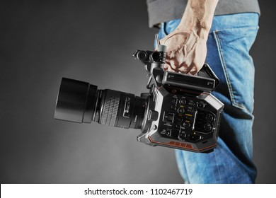 Kiev, Ukraine - April 22, 2018: Cameraman holds an movie camera Panasonic AU-EVA1 in studio