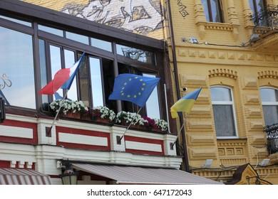 Kiev, Ukraine - April 24: Flags of France, the European Union and Ukraine, on April 24, 2017 in Kiev, Ukraine