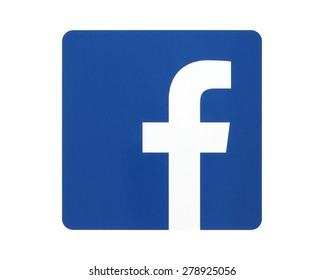 KIEV, UKRAINE - APRIL 27, 2015: Facebook logo sign printed on paper and placed on white background. Facebook is a well-known social networking service.