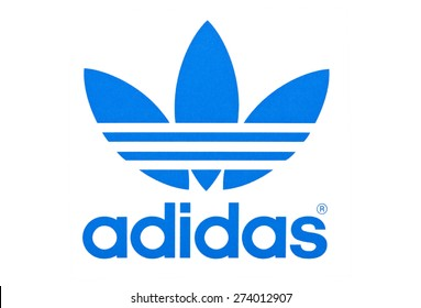 KIEV, UKRAINE - APRIL 29, 2015:  Logo of  brand Adidas  printed on paper and placed on white background.  Adidas - German industrial group specializing in the production of athletic footwear, apparel.
