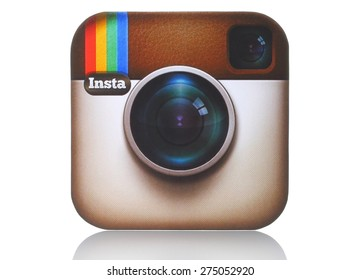 KIEV, UKRAINE - APRIL 29, 2015:Instagram logotype camera printed on paper and placed on white background. Instagram is an online mobile photo-sharing, video-sharing service.