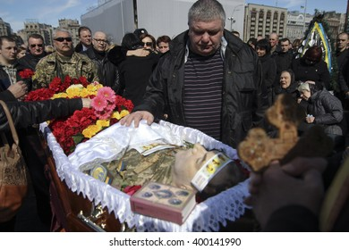 KIEV, UKRAINE - April 3, 2016: People attend a funeral ceremony of Ukrainian serviceman Dmytro Godzenko