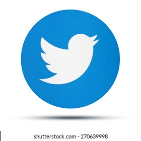 KIEV, UKRAINE - APRILE 16, 2015: Twitter logotype printed on paper. Twitter social network for public exchange of short messages using the web interface, SMS, instant messaging tools.